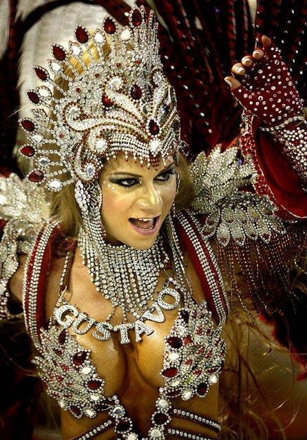 A Sao Clemente samba school dancer performs at the Sambadrome in Rio de Janeiro