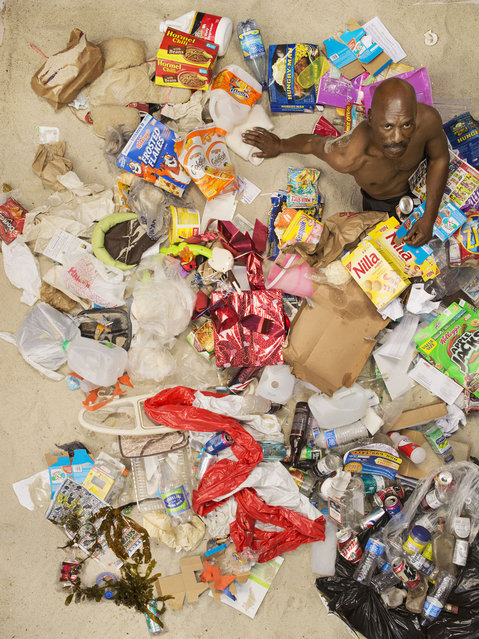John surrounded by seven days of his own rubbish in Pasadena, California. (Photo by Gregg Segal/Barcroft Media)