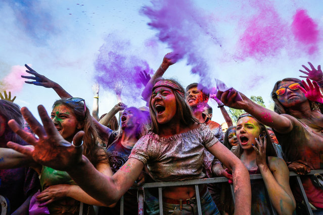 "Participants enjoy the ""Festival of Colors"" in Kiev, Ukraine, 25 June 2016. The event is inspired by the traditional Hindu Holi spring festival of colors in India. (Photo by Roman PilipeyEPA)"