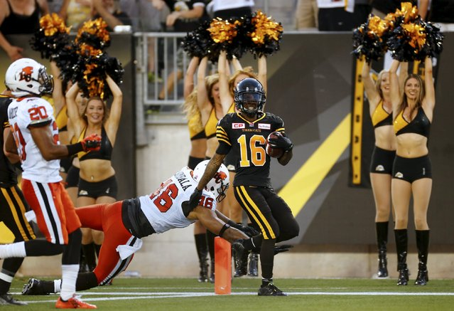 Hamilton Tiger-Cats Brandon Banks scores a touchdown past B.C. Lions Rolly Lumbala during the first half of their CFL football game in Hamilton, Ontario, Canada, August 15, 2015. (Photo by Mark Blinch/Reuters)