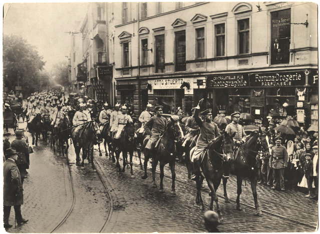 German soldiers and officers ride on horseback down an unidentified street in a town. (Photo by Dr. P.A. Smithe/National World War I Museum, Kansas City, Mo.)