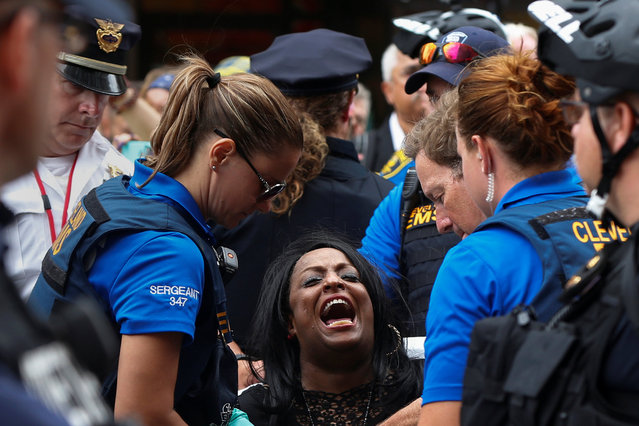 A woman yells as she is taken into custody by police during the Republican National Convention in Cleveland, Ohio, U.S. July 18, 2016. (Photo by Shannon Stapleton/Reuters)