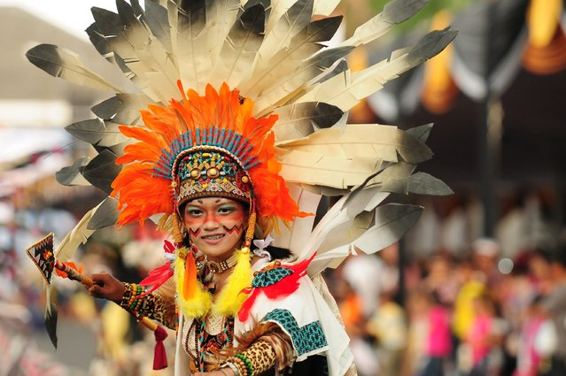 A model wears an Apache costume in the kids carnival during The 13th Jember Fashion Carnival 2014 on August 21, 2014 in Jember, Indonesia. (Photo by Robertus Pudyanto/Getty Images)