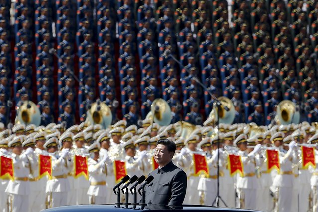 Chinese President Xi Jinping reviews the army lined at Tiananmen Square at the beginning of the military parade marking the 70th anniversary of the end of World War Two, in Beijing, China, September 3, 2015. (Photo by Damir Sagolj/Reuters)