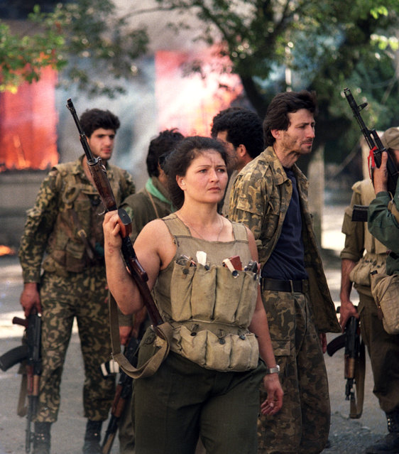 Sukhumi, Abkhazia, 1993. Abkhaz militiamen during street clashes in the 1992-1993 Georgian–Abkhaz conflict. (Photo by Andrei Solovyov/ITAR-TASS)