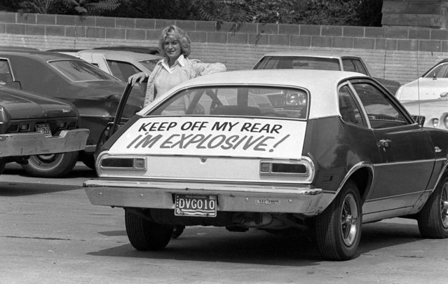Patty Ramge, posing September 1,1978 with her 1975 Ford Pinto, has little trouble with motorists tailgating since she decked her car with a sign warning of its' explosive nature if hit from the rear. Mrs. Ramge posted the warning after weeks of trying to convince Ford Motor Co., and its dealers to modify the fuel tank so it would not pose a fire hazard in a rear-end crash. (Photo by AP Photo)