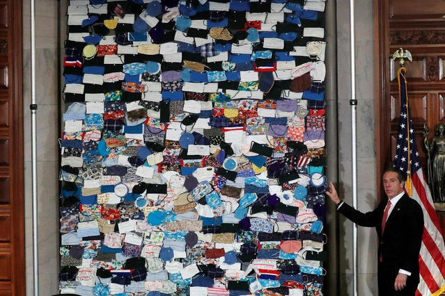 New York Governor Andrew Cuomo unveils a mural made up of hundreds of protective face masks sent to New York State from people all across the United States during the outbreak of the coronavirus disease (COVID-19) at the State Capitol in Albany, New York, U.S., April 29, 2020. (Photo by Mike Segar/Reuters)