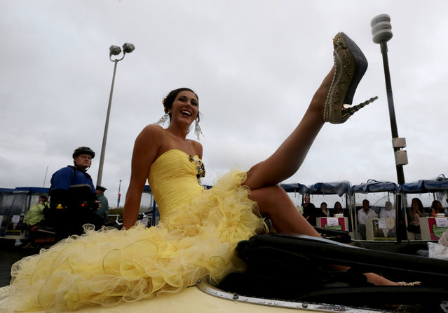 Miss Utah Karlie Major displays her shoe during the Miss America Shoe Parade at the Atlantic City boardwalk, Saturday, September 13, 2014, in Atlantic City, N.J. (Photo by Julio Cortez/AP Photo)