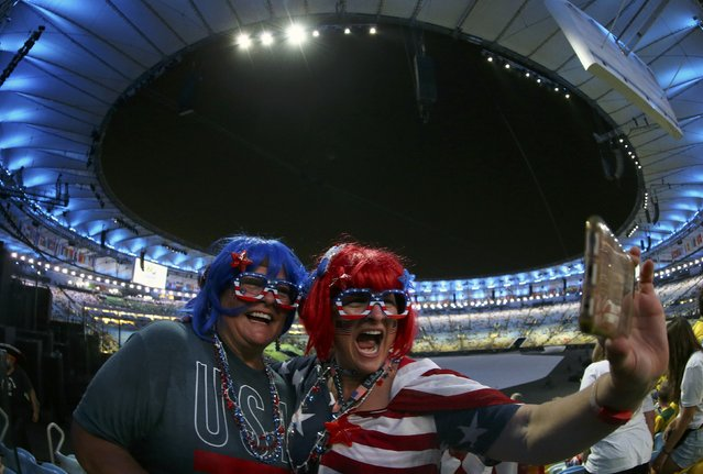 2016 Rio Olympics, Opening ceremony, Maracana, Rio de Janeiro, Brazil on August 5, 2016. American fans take a selfie before the start of the opening ceremony. (Photo by Jeremy Lee/Reuters)