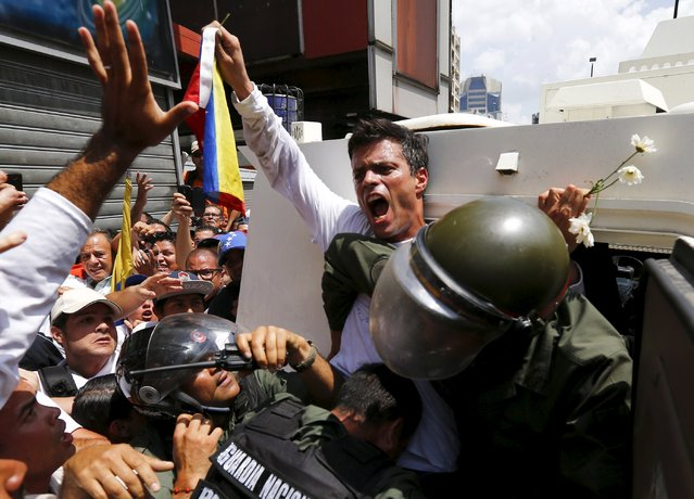Venezuelan opposition leader Leopoldo Lopez gets into a National Guard armored vehicle in Caracas in this February 18, 2014 file photo. (Photo by Jorge Silva/Reuters)