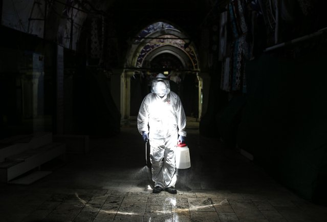 Municipality officials carry out disinfection works at Grand Bazaar, which was closed on March 23 within the coronavirus (Covid-19) measures, ahead of its opening on June 1, in Istanbul, Turkey on May 30, 2020. (Photo by Elif Ozturk/Anadolu Agency via Getty Images)