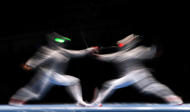 Yana Egorian of Russia competes against Tania Arrayales of Mexico during the Women's Sabre Team Quarterfinals on August 13, 2016 in Rio de Janeiro, Brazil. (Photo by Jamie Squire/Getty Images)