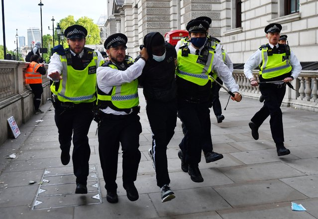 A demonstrator is detained by Police on Whitehall during a Black Lives Matter protest in London, following the death of George Floyd who died in police custody in Minneapolis, London, Britain, June 7, 2020. (Photo by Dylan Martinez/Reuters)