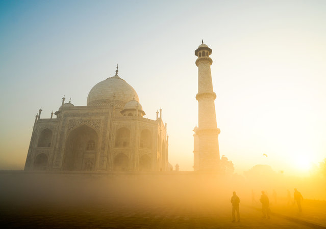 """""""Taj Mahal sunrise"""". In the early morning, the fog of early march spreads the light. It s like we were still under drugs. Photo location: Agra, India. (Photo and caption by Thomas Dorleans/National Geographic Photo Contest)"""