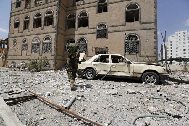 A soldier walks at the site of a Saudi-led air strike in Yemen's capital Sanaa September 16, 2015. (Photo by Khaled Abdullah/Reuters)