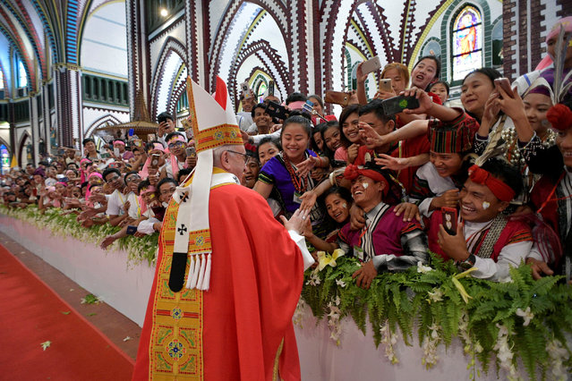 Pope Francis blesses faithful during a Mass at St Mary's Cathedral in Yangon, Myanmar November 30, 2017. (Photo by Osservatore Romano/Reuters)