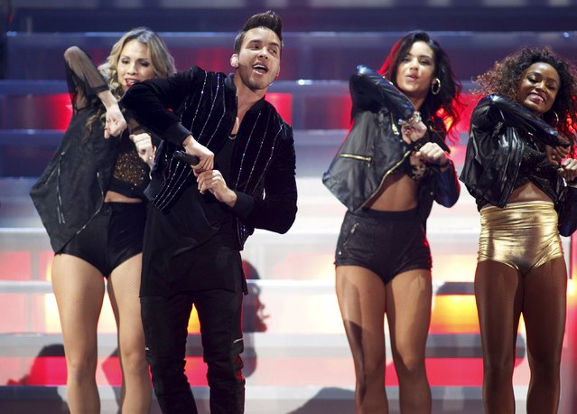 Prince Royce performs with dancers during the second night of the 2015 iHeartRadio Music Festival at the MGM Grand Garden Arena in Las Vegas, Nevada September 19, 2015. (Photo by Steve Marcus/Reuters)