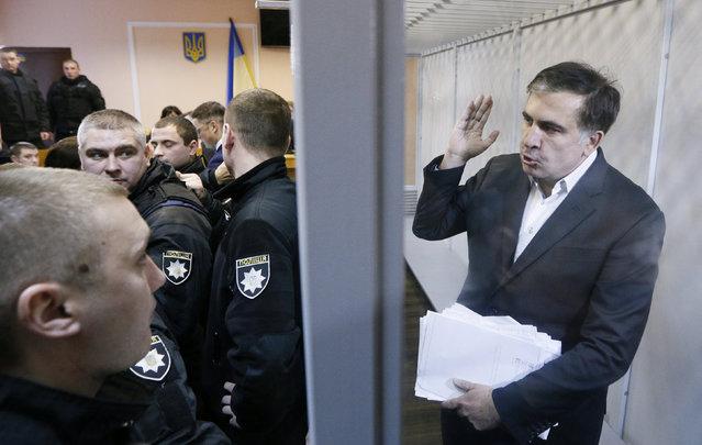 Ukrainian opposition figure and Georgian former President Mikheil Saakashvili gestures inside a defendants' cage as he attends a court hearing in Kiev, Ukraine December 11, 2017. (Photo by Valentyn Ogirenko/Reuters)
