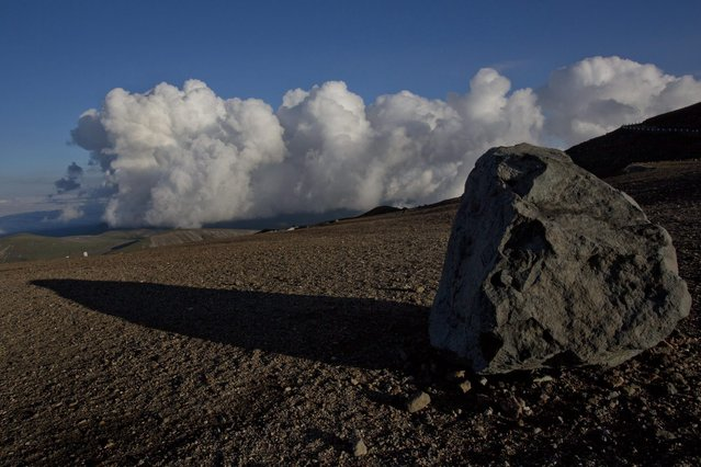 In June 18, 2014 photo, a boulder lies on a path near the peak of Mount Paektu in North Korea's Ryanggang province. (Photo by David Guttenfelder/AP Photo)