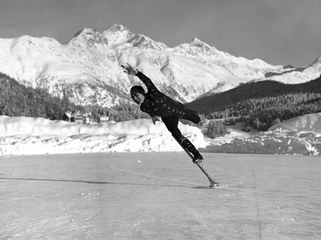 Britain's Phil Taylor, speed and acrobatic skater, thrilled winter sports enthusiasts with his daring antics on stilts, skating at St. Moritz, Switzerland, on December 27, 1938. (Photo by AP Photo)