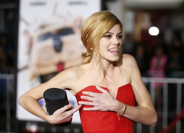 """Actress Rachel Melvin adjusts her dress as she poses at the world premiere of the film """"Dumb and Dumber To"""" in Los Angeles, November 3, 2014. (Photo by Danny Moloshok/Reuters)"""
