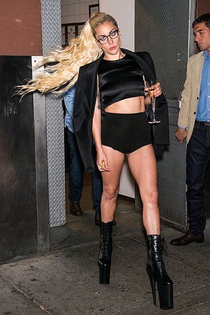 Lady Gaga is seen leaving with champagne flute glass and waiving her long curly blond ponytail as she exits Brandon Maxwell fashion show at Russian Tea Room in New York City, NY on September 13, 2016. (Photo by Ouzounova/Splash News)