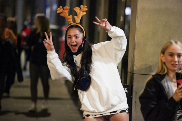 A girl poses in antlers ahead of a curfew on pub in Nottingham, a city in central England's Midlands region on September 21, 2020 as Freshers' Week got underway. Revellers were also pictured out in Birmingham, which was plunged into a local lockdown amid a surge in coronavirus cases. (Photo by Ashley Kirk/The Sun)