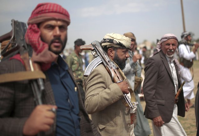 Tribesmen loyal to Houthi rebels hold their weapons as they attend a gathering against the agreement to establish diplomatic relations between Israel and the United Arab Emirates in Sanaa, Yemen, Saturday, August 22, 2020. (Photo by Hani Mohammed/AP Photo)