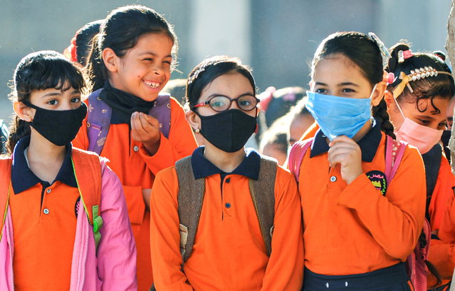 Students wearing protective face masks attend the first day's class at El Safa school, following months of closure due to the coronavirus disease (COVID-19) outbreak in the Giza suburb of Awsim, Egypt on October 18, 2020. (Photo by Shokry Hussien/Reuters)