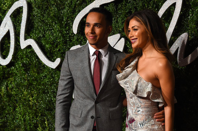 Racing driver Lewis Hamilton and singer Nicole Scherzinger pose for photographers upon arrival at The British Fashion Awards 2014, in London, Monday, December 1, 2014. (Photo by Jonathan Short/Invision/AP Photo)