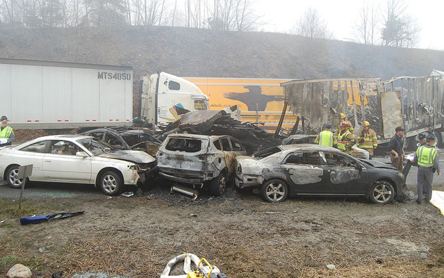 Rescue workers look over the scene on I-77 where approximately 75 vehicles were involved in an accident in Carroll County, Virginia near the North Carolina state line in this March 31, 2013 photo. Three people are reported dead and 25 are reported injured. Fog was a contributing factor to the pileup, investigators said. (Photo by Sgt. Mike Conroy/AP Photo/Virginia State Police gives)