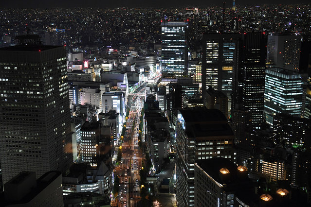 The lights from a bustling city illuminates the evening on Friday November 04, 2016 in Tokyo, Japan. (Photo by Matt McClain/The Washington Post)