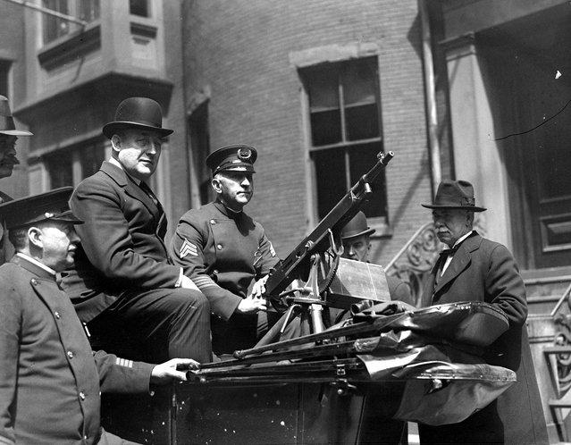 Superintendent Michael Crowley with machine gunners at headquarters. They are ready for big May Day riots, 1920. (Photo by Leslie Jones)