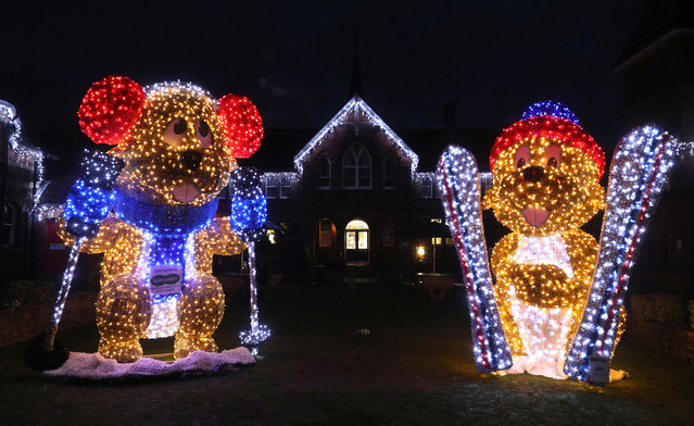 """Two 16ft illuminated Marmots, """"Marmite"""" (left) and """"Meribel"""", which have been erected outside the Assembly Rooms in Alton, Hampshire on November 25, 2020, as part of the town's MarmART trail. (Photo by Andrew Matthews/PA Images via Getty Images)"""