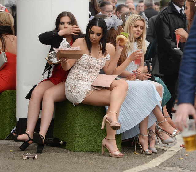 Racegoers during Ladies Day at the Grand National Festival at Aintree Racecourse on April 13, 2018 in Liverpool, England. (Photo by News Group Newspapers Ltd)