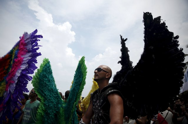 Revellers take part in a LGBT Pride Parade in Copacabana beach in Rio de Janeiro, Brazil, November 15, 2015. (Photo by Pilar Olivares/Reuters)