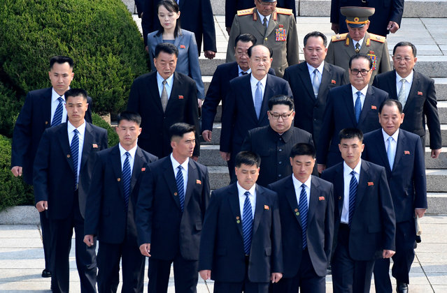 North Korean leader Kim Jong Un, center, is surrounded by his security guards upon his arrival for a meeting with South Korean President Moon Jae-in at the North Korea side of Panmunjom in the Demilitarized Zone, South Korea, Friday, April 27, 2018. (Photo by Korea Summit Press Pool via AP Photo)