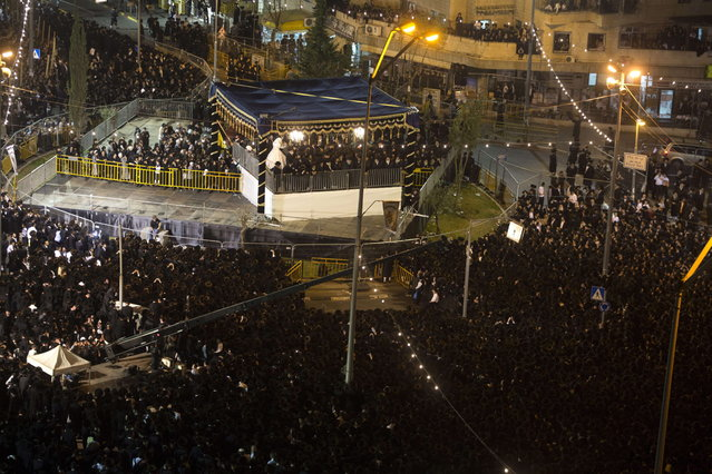 Tens of thousands of Ultra-Orthodox Jews of the Belz Hasidic Dynasty watch the wedding ceremony of Rabbi Shalom Rokach, the Grandson of the Belz Rabbi to Hana Batya Pener, in Jerusalem on May 21, 2013. Some 25,000 Ultra-Orthodox Jews participated in one of the biggest weddings in the past few years. (Photo by Menahem Kahana/AFP Photo)