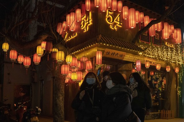 Patrons wearing masks to protect from the coronavirus visit a bar street on New Year Eve in Beijing on Thursday, December 31, 2020. (Photo by Ng Han Guan/AP Photo)