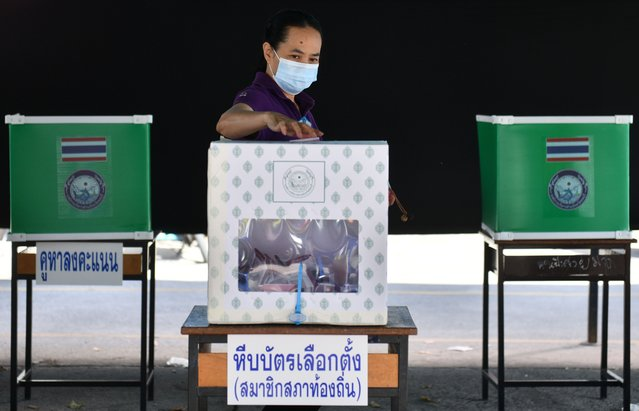 A woman casts her vote at a polling station during provincial elections in Chonburi province in Thailand, December 20, 2020. (Photo by Chalinee Thirasupa/Reuters)