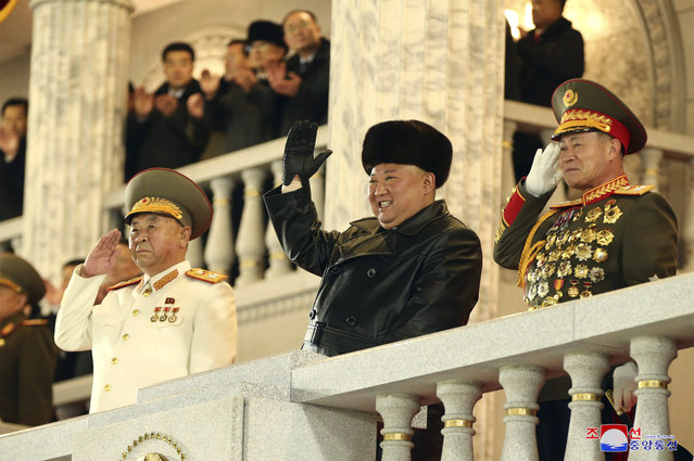 In this photo provided by the North Korean government, North Korean leader Kim Jong Un waves as Kim attended a military parade, marking the ruling party congress, at Kim Il Sung Square in Pyongyang, North Korea Thursday, January 14, 2021. (Photo by Korean Central News Agency/Korea News Service via AP Photo)