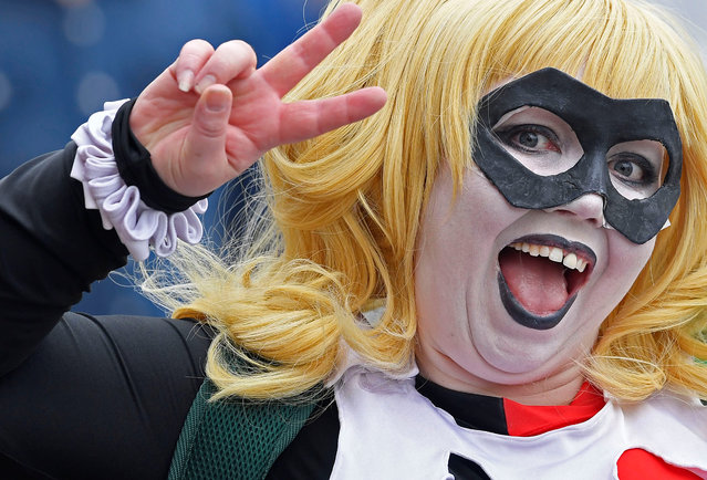 An attendee arrives at the MCM London Comic Con, a convention to celebrate the culture of comic books and related art forms, in London, Britain, May 25, 2018. (Photo by Toby Melville/Reuters)