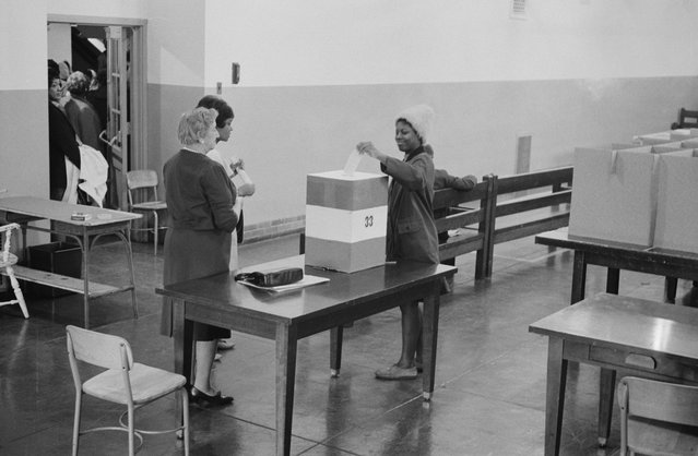 A young woman casts her ballot at Cardoza High School in Washington D.C., November 3, 1964. (Photo by Reuters/Library of Congress)