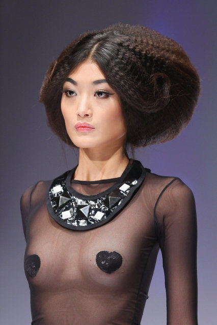 A model walks the runway during TONI&GUY Trends Release 2010 at 2010 China Fashion Week S/S Collection on November 9, 2009 in Beijing, China.  (Photo by Feng Li/Getty Images)