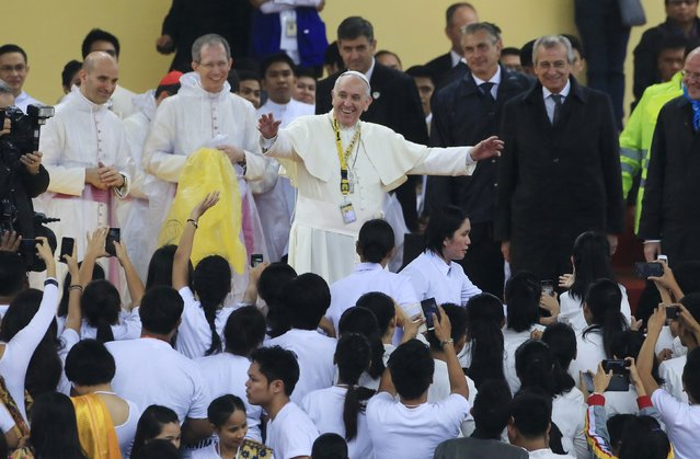 Pope Francis gestures during a meeting with the youth at the University of Santo Tomas in Manila January 18, 2015. (Photo by Romeo Ranoco/Reuters)