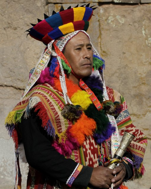 A Peruvian indigenous man attends an Andean ceremony with Bolivia's President Evo Morales (not pictured) in Tiahuanaco some 70 km from La Paz, January 21, 2015. (Photo by David Mercado/Reuters)