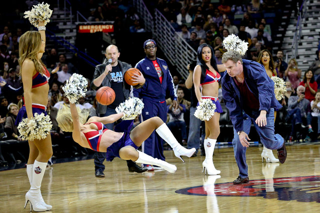 """Will Ferrell hits an actress playing a member of the New Orleans Pelicans dance team with a ball during a stunt filmed for the movie """"Daddy's Home"""" at halftime of a game against the Los Angeles Lakers in New Orleans, January 21, 2015. (Photo by Derick E. Hingle/USA TODAY Sports)"""