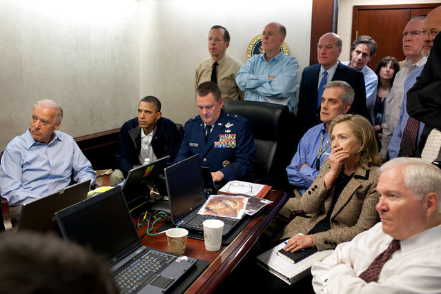 U.S. President Barack Obama (2nd L) and Vice President Joe Biden (L), along with members of the national security team, receive an update on the mission against Osama bin Laden in the Situation Room of the White House, May 1, 2011. (Photo by Pete Souza/Reuters/White House)