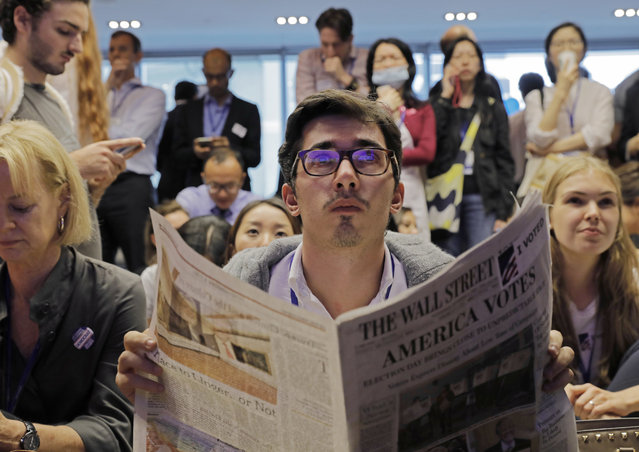 A man reacts as they watch a television broadcast of U.S. election in Hong Kong, Wednesday, November 9, 2016. The United States headed for the polls to vote for their new president on Tuesday. (Photo by Vincent Yu/AP Photo)