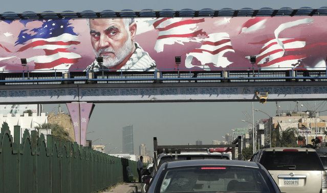 An overpass above the highway leading the Lebanese capital Beirut to the southern areas is pictured ahead of the first anniversary of the killing of Iranian Revolutionary Guards commander Qasem Soleimani (portrait), on December 31, 2020 in Beirut. On January 3, Iraq will mark a year since a US drone strike killed Iraqi commander Abu Mahdi al-Muhandis, the deputy head of Iraq's powerful Tehran-aligned Hashed Al-Shaabi paramilitary network, alongside Soleimani, head of the elite external operations of Iran's Revolutionary Guards, nearly sparking a conflict that many fear could still ignite. (Photo by Anwar Amro/AFP Photo)